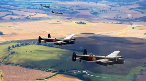 A British Treat: 2 Lancasters Escorted By 2 Spitfires