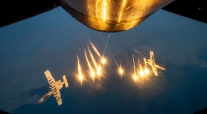 A-10s Refuel Midair And Exit With Spectacular Flares
