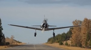 WWII Era Plane Comes Straight At The Cameraman- Might Make You Flinch!