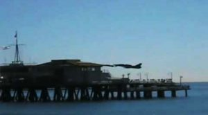 Civilian Buzzes Pier With Small Military Jet- Scaring Everyone