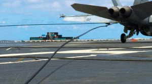 Hornet Snaps Arresting Cable, Sends Deck Crew Flying
