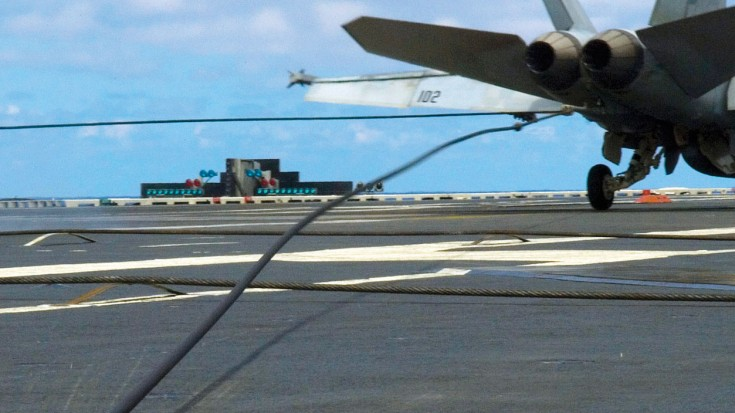 Hornet Snaps Arresting Cable Sends Deck Crew Flying