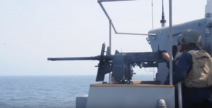 Navy Firing Twin 50 Cal Machine Gun and Cannons
