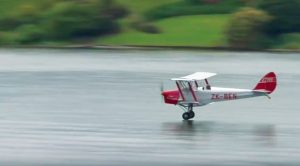 Tiger Moth Pilot Grazes Water Surface At Full Speed