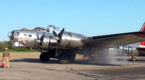 Tremendous Shiny B-17 Rumbles Its Smokey Engine