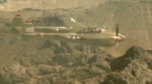 Powerful P-38 Lightning Roaring Through The Mountains
