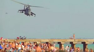 Insane Helicopter Pilot Bolting Dangerously Low Over Unsuspecting Beachcombers