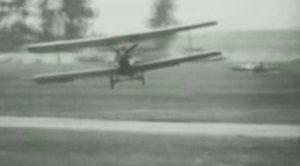 German Ace Performs A Dead Stick Loop And Side Slip Landing With Bi-Plane-Lands Dead Center