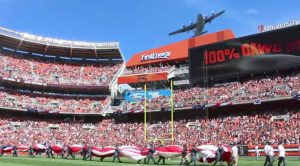 Holy Moly!! C-130 Dips Low Right Over Football Stadium-Crowd Goes Wild