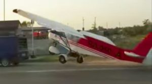 Plane Tries Taking Off On Jammed Road, Ends Up Slamming Into Parked van