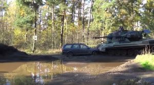 Footage Of What A Tank Flying Full Speed Does To A Dinky Car