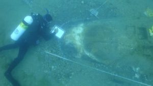 Archaeologists Searching Plane Crash Recover Long-Lost WWII Relic