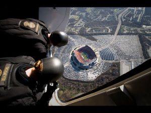 Insane Navy SEALS' Parachute Jump Into Football Game